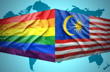 Waving Malaysian and Gay flags