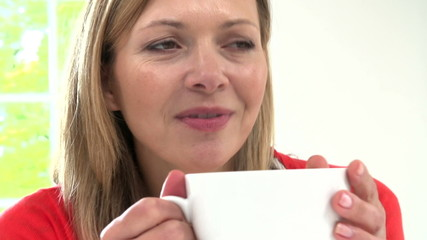 Woman Relaxing At Home With Hot Drink