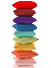 Group of multicolor pillows on white background