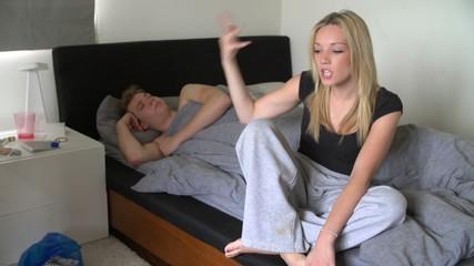 Teenage Couple Having Argument In Bedroom
