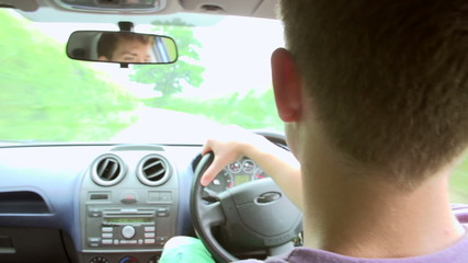 Interior View Of Teenage Boy Driving Car