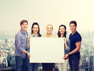 group of standing students with blank white board