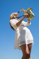 Musician against the sky