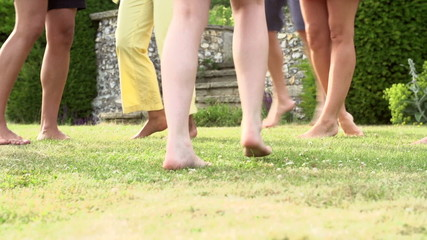 Slow Motion Sequence Of Feet Having Fun In Garden