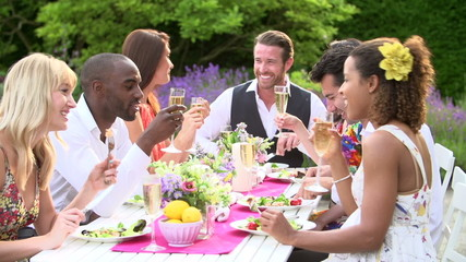 Slow Motion Shot Of Friends Enjoying Outdoor Dinner Party