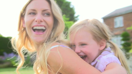 Mother And Daughter Having Fun In Garden