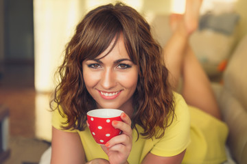 Attractive woman taking a coffee or tea break