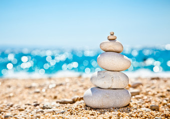 Stack of zen stones on beach.