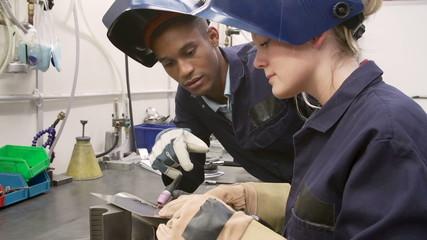 Engineer Teaching Apprentice To Use TIG Welding Machine