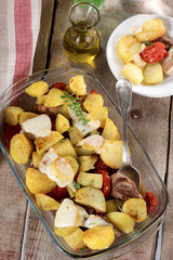 Potato gratin with meat and tomatoes