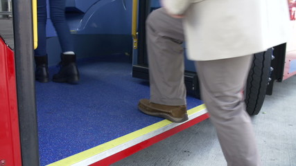 Close Up View Of Passenger's Feet Boarding Bus