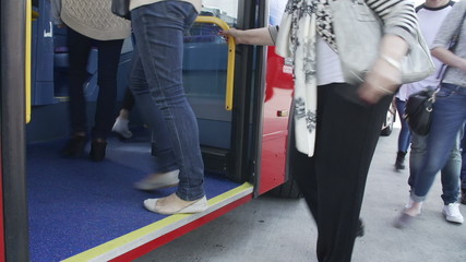 Time Lapse View Of Passenger's Feet Boarding Bus