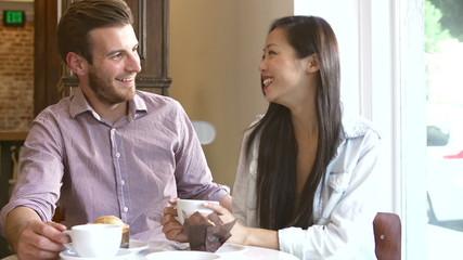 Couple Meeting In Café Restaurant