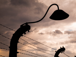 Lamp silhouette in concentration camp