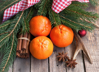 Fresh tangerine and christmas decorations