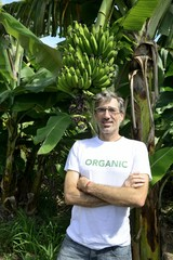 Organic farmer in front of banana plantation