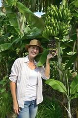 Woman visiting banana plantation