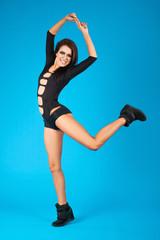 Pretty woman in swimsuit dancing