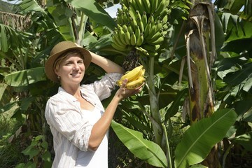 Woman visiting banana plantation
