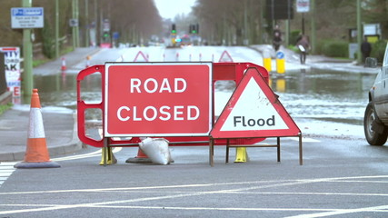 Sign Warning Of Road Closure Due To Flooding