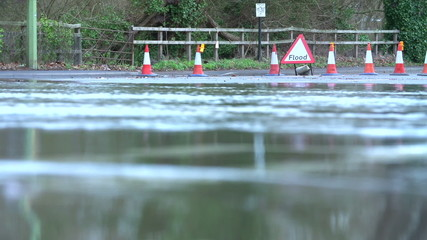 Flood Warning Sign On Road