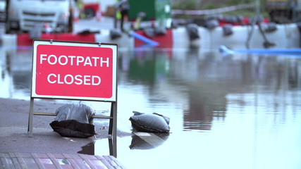 Sign Warning Of Footpath Closure Due To Flooding