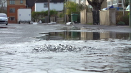 Flood Water Escaping From Drain Cover In Slow Motion
