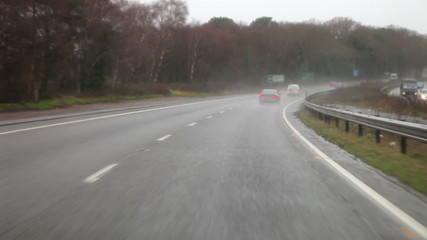 Time Lapse Sequence Of Motorway Journey In Rain