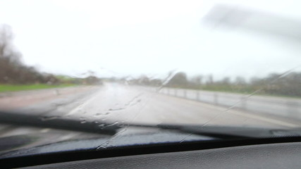 Rainy Car Journey Viewed Through Windscreen