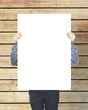 man holding blank paper