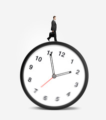 businessman walking on clock