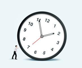 businessman pulling clock