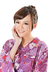 smiling Japanese beauty in traditional clothes