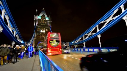 Traffic crosses Tower Bridge in London