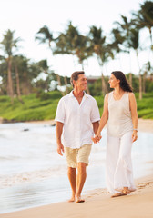 Mature Couple Enjoying Walk on the Beach