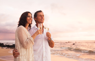 Romantic Couple Drinking Champagne on the Beach at Sunset