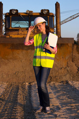 Pretty woman working on construction site
