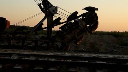 Train on huge excavator background