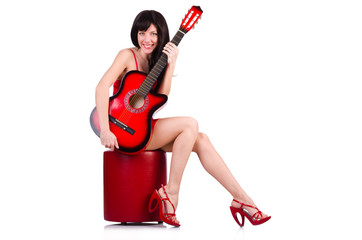 Woman in red dress playing guitar isolated on the white