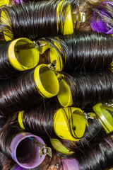 Hair during hair dressing with curler.