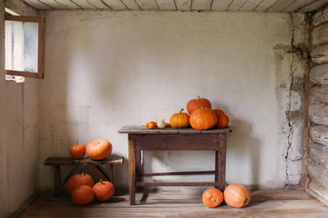 pumpkins in old rustic room