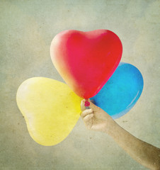Multi colored balloons toned with a retro vintage