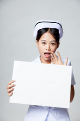 Young Asian nurse surprise with blank sign