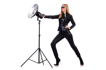 Woman in black leather dress in studio shootout