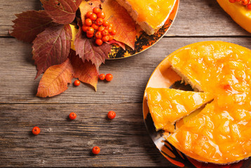 pumpkin and pie on wooden table