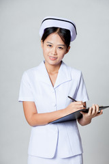 Happy young Asian nurse is working