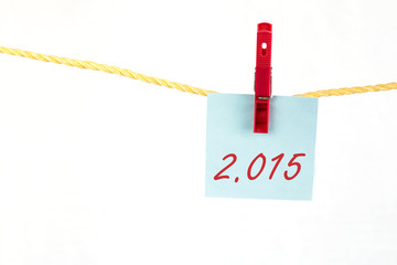 Note colored paper with the word 2015