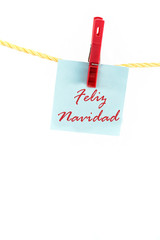 Note colored paper with the word feliz navidad