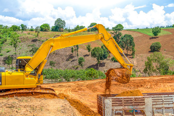 Backhoe loader loading dumper