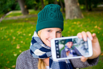 Beautiful girl taken pictures of her self in fall
